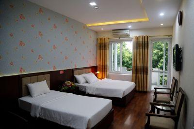 Phòng đẹp tiêu chuẩn 1 giường đơn & 1 giường đôi