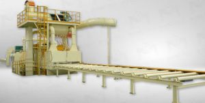 Máy phun bi dạng băng tải con lăn
