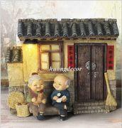 Tượng ông bà ngồi ghế trước nhà ( gồm nhà)