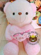 Gấu ôm tim Love hồng, chân hồng (1m2, 1m4)