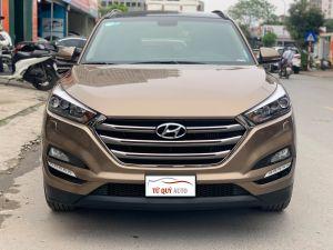 Xe Hyundai Tucson 2.0AT CRDi 2017 ĐK 2018 - Vàng Cát