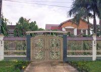Cổng nhà biệt thự bằng đồng đúc